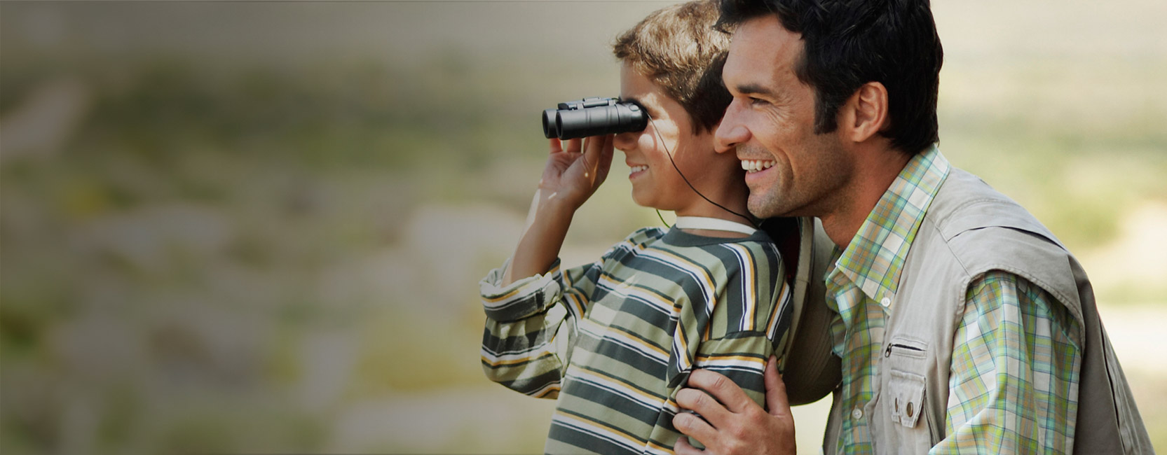 Father and Son Looking through binoculars