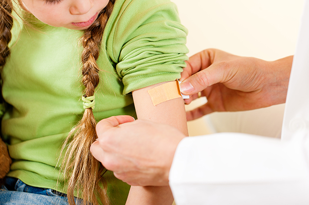 Little girl getting the measles vaccine, why get vaccinated lg