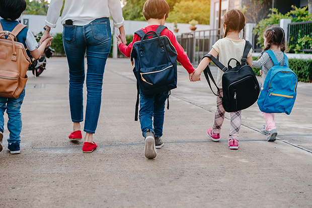 Mom with children taking them back to school