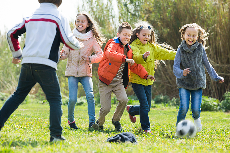 Children playing, reducing risk of childhood obesity