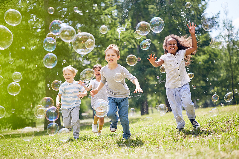 Kids running with bubbles, fun ways to keep your kids active