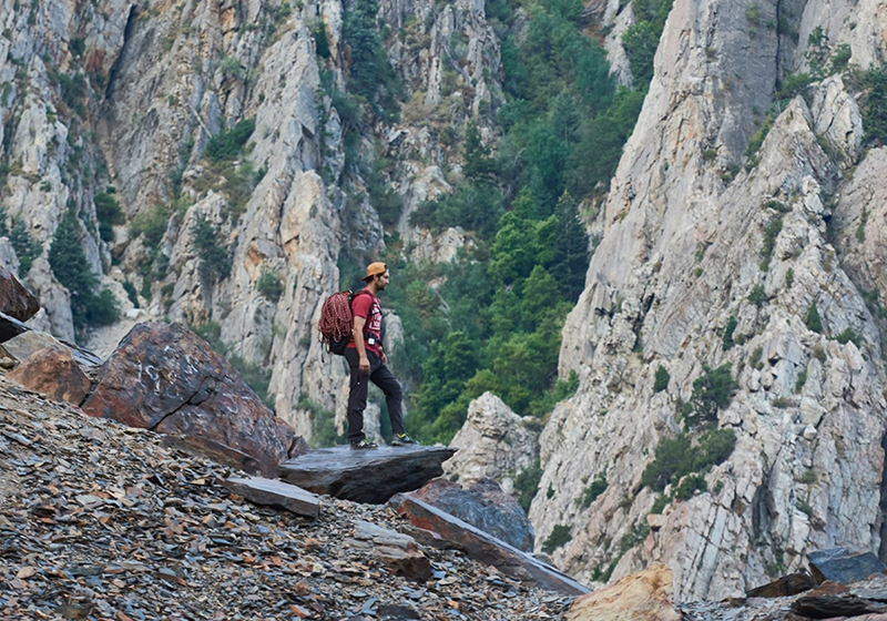 Man getting ready to rock climb, health insurance survival guide tips