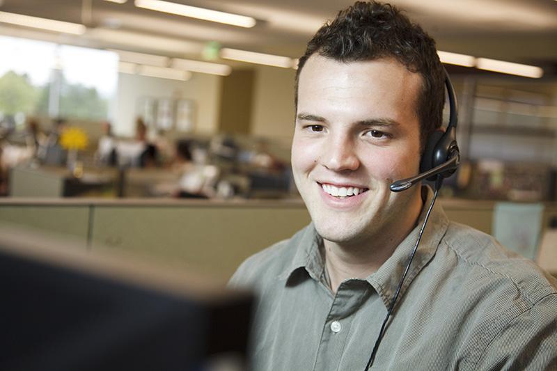 Man on phone, open enrollment tips