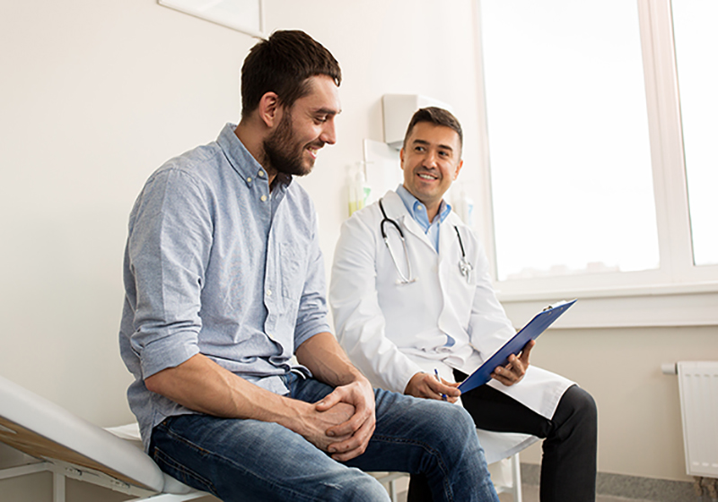 Man and doctor talking about preventive care