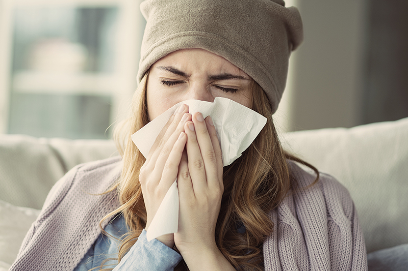 Woman with a cold, ways to combat cold and flu season
