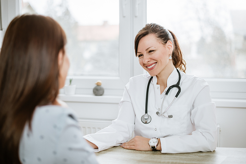 Woman talking with her doctor, being her own health advocate