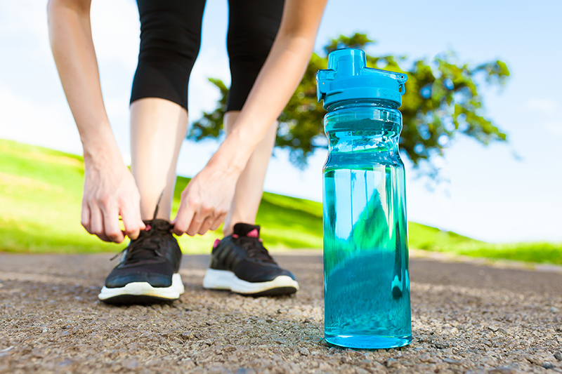 Building lasting health habits, woman and water bottle