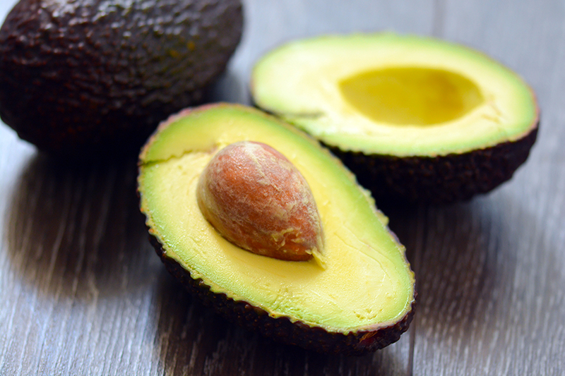 Sliced avocados on a table, what are the health benefits of avocados