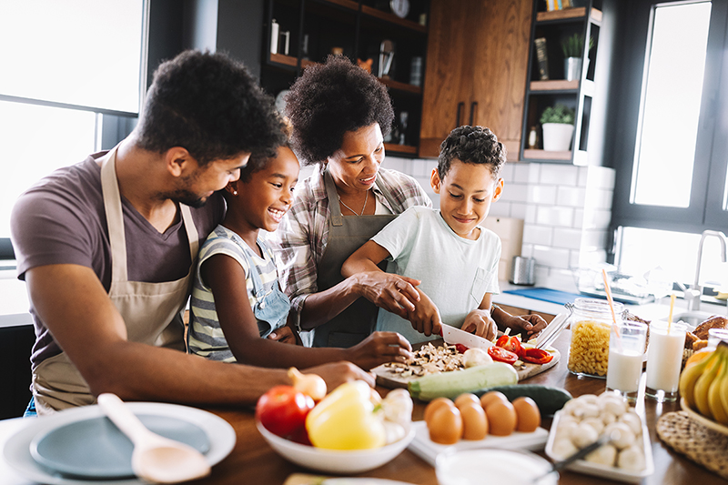 family cooking in the kitchen together, healthy meals to make during isolation