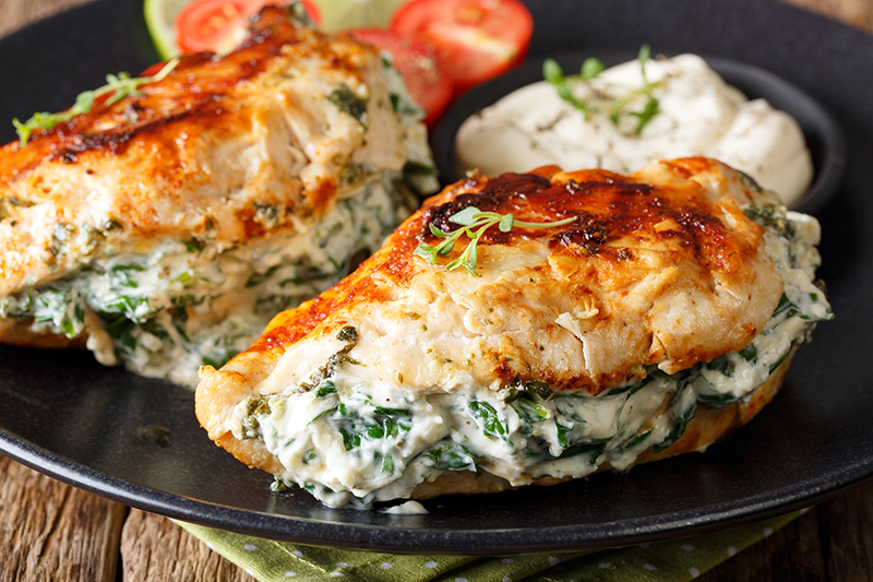 Healthy spinach stuffed chicken on a plate, recipe