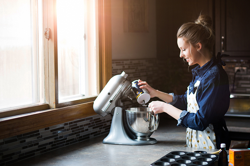 Woman who loves to bake, mixing ingredients in her kitchen