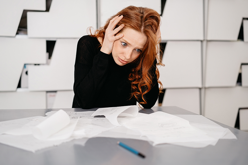 Woman feeling stressed, what are the effects of stress on your body