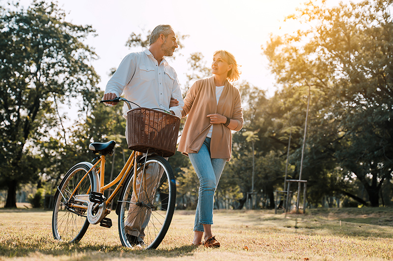 Older couple walking along, practicing nutrition as they age