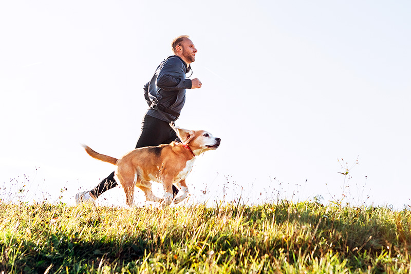 Man running with his dog, health tips for men over 30
