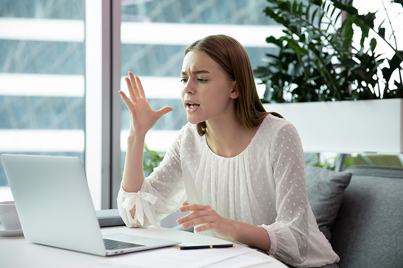 Woman getting impatient with her computer, is your impatience causing you stress?