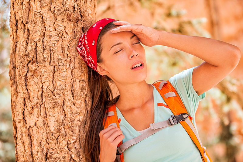 Woman hiker suffering from heat stroke, what are the symptoms and treatments for heat stoke/exhaustion