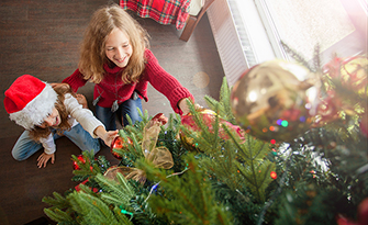 Kids decorating tree, 5 ways to have a safe holiday sm