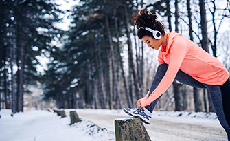 Woman working out during the winter time, staying motivated even though it's cold out sm