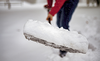 Man shoveling his driveway, how to be prepared for a winter storm sm