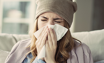 Woman with a cold, ways to combat cold and flu season sm