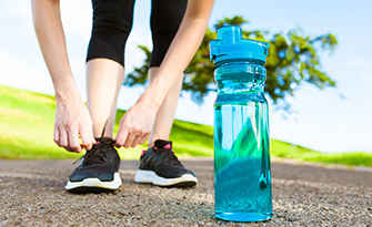 Building lasting health habits, woman and water bottle sm