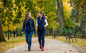 Women walking, benefits of getting 10,000 steps sm