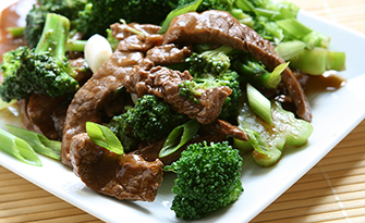 Beef and broccoli stir fry sitting on a plate, recipe sm