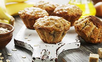 Oatmeal banana chocolate chip muffins on a cutting board, recipe sm