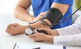 What is high blood pressure? Woman taking someone's blood pressure sm