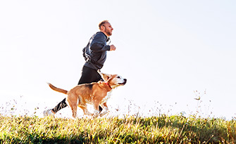 Man running with his dog, health tips for men over 30 sm