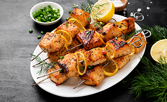 Salmon kebabs with lemon on a plate, recipe sm