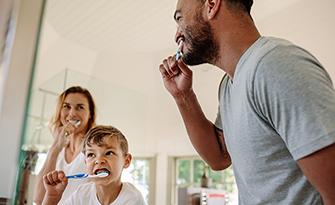 Family in bathroom learning exercises you can do while brushing your teeth sm