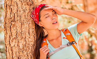 Woman hiker suffering from heat stroke, what are the symptoms and treatments for heat stoke/exhaustion sm