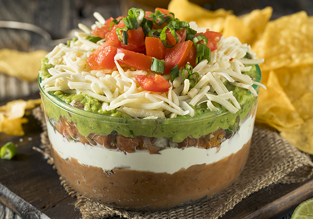 Quick and easy 7-layer bean dip for the Superbowl or any gathering