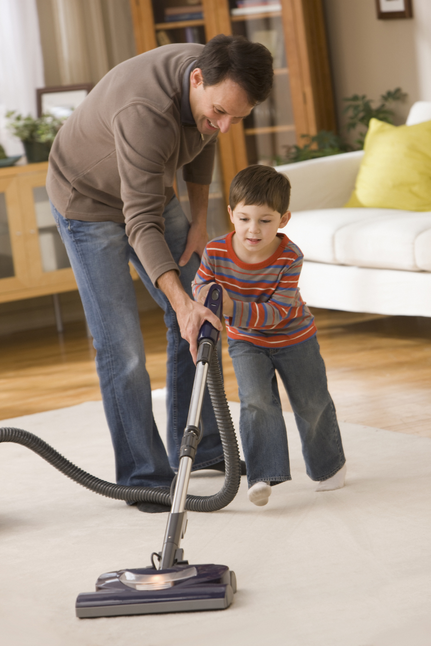 Father and Son Vacuuming