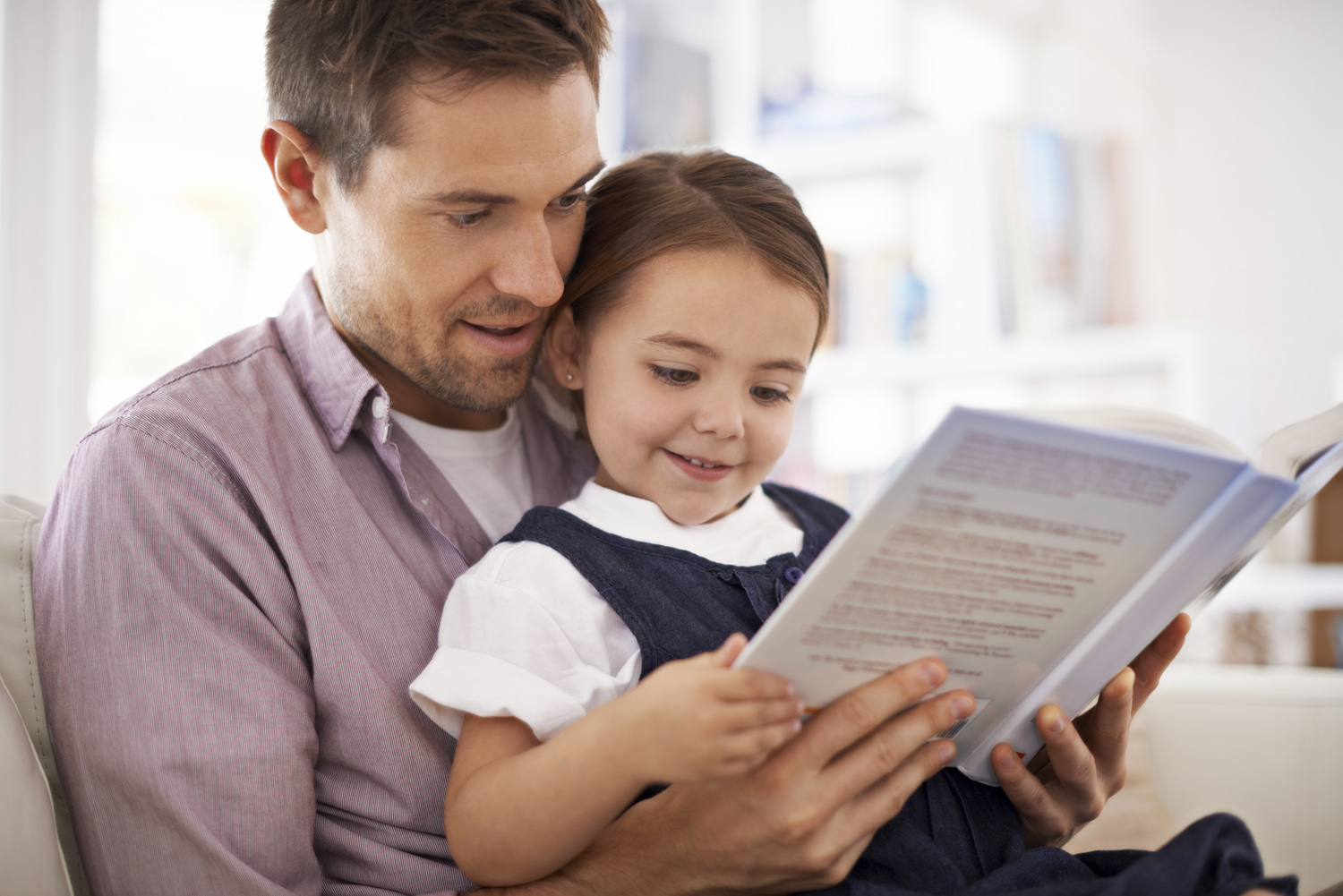 Father reading with daughter