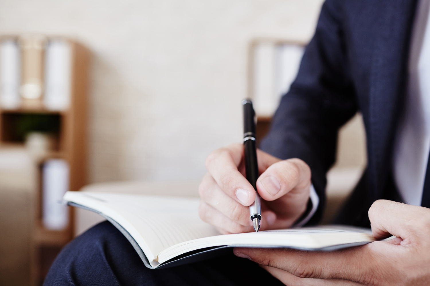 Man in Suit Writing