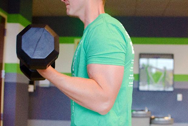 Man works out his biceps