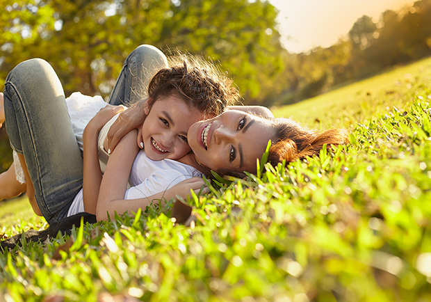 How to cultivate happiness, mother and daughter playing in the grass
