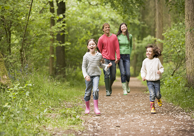 Family walking, maintaining a healthy lifestyle together