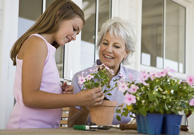 Grandmother and grandaughter planting flowers, way's to stay sharp as you age