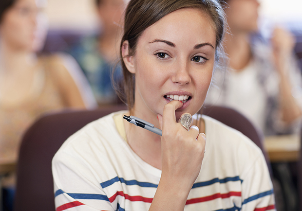 Nervous habits that may be affecting your health, girl biting her nails