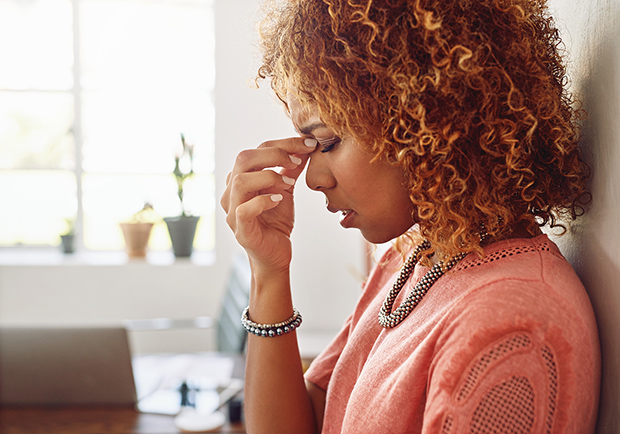 A women exhibiting signs of stress. Stress can negatively effect your health.