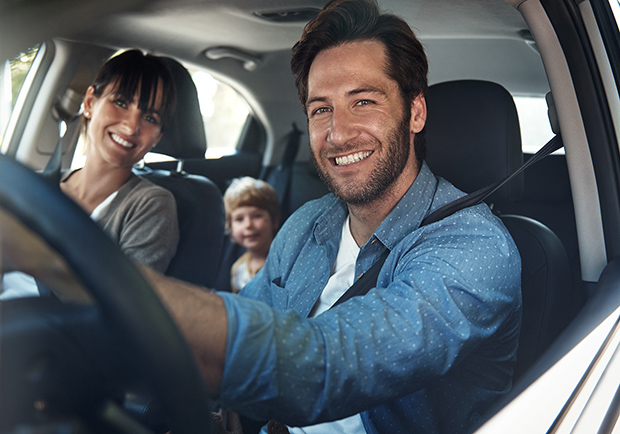 Family driving together in a car. Tips and methods to stay safe while traveling