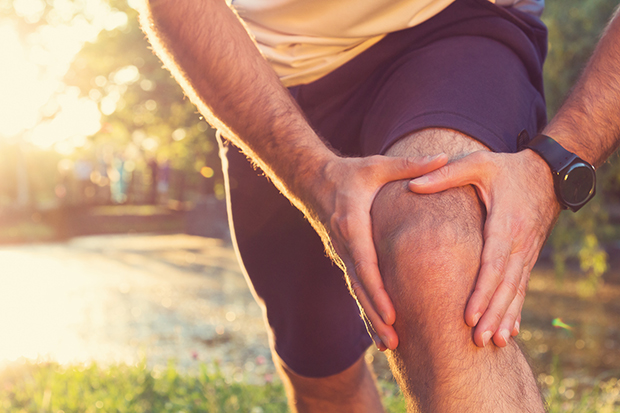 Man stretching. Use these stretches to help protect your knees from injury