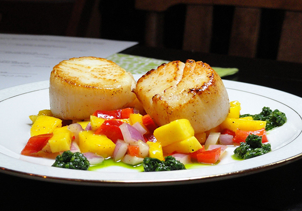 Scallops on a plate with mango relish, recipe from Chef Mary