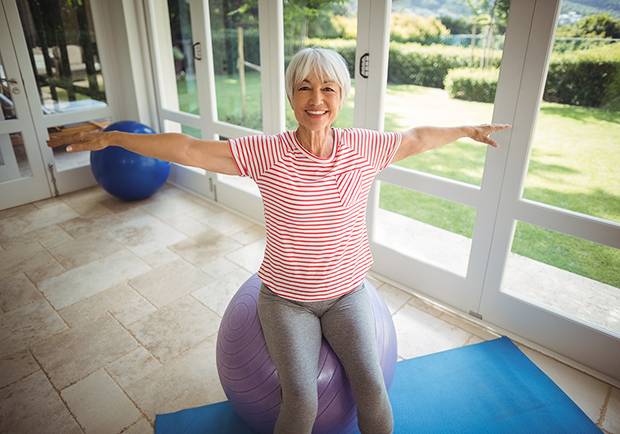 Older woman on yoga ball, doing fall prevention tips