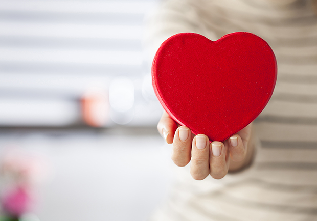 Hand holding a heart. Simple ways you can maintain heart-health
