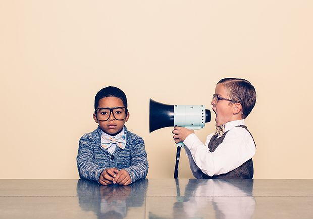 Two boys, one with a megaphone. How to communicate better.