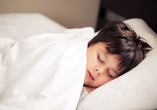 How to stop your child from bedwetting, image of child sleeping